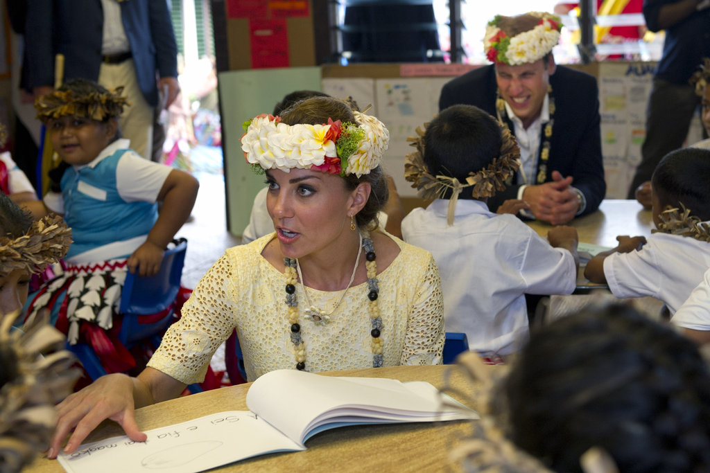 The Duchess was given a floral headdress at a primary school.