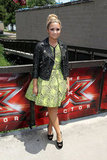 At The X Factor auditions in Austin, Demi popped in a neon printed Topshop dress and a Topshop black leather snakeskin biker jacket. This Georgie faux python cream jacket ($298) is equally fabulous.