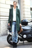 A sleek olive coat gave distressed jeans and a silky button-down a polished finish. Source: Greg Kessler