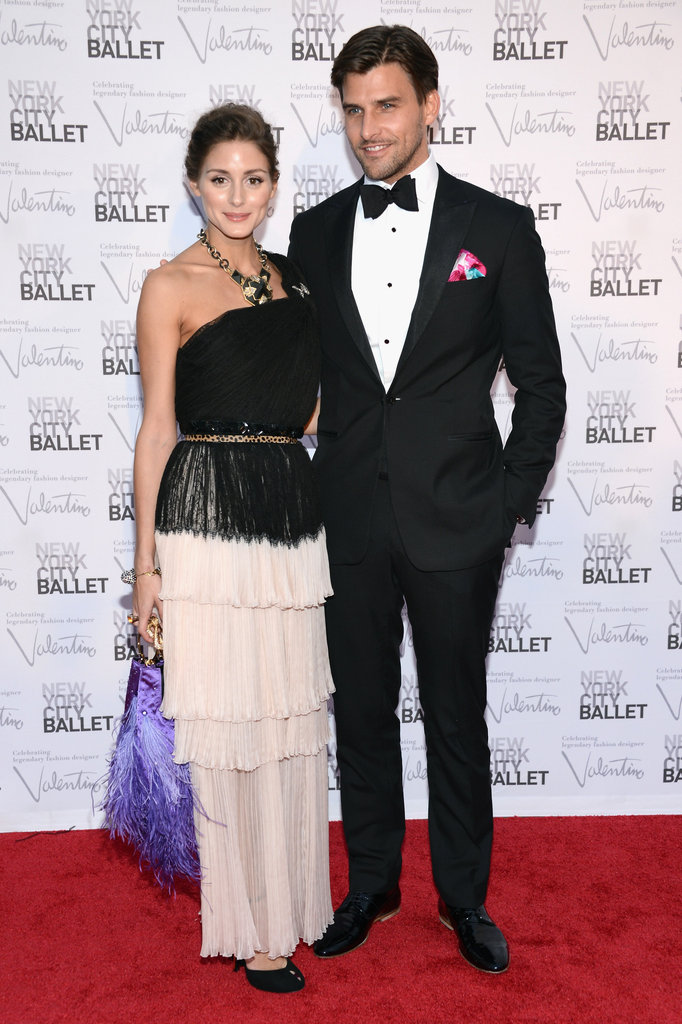 Olivia Palermo opted for a tiered Christian Dior gown, purple bag, and statement necklace.