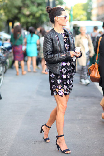 It takes a confident styler to pull off a dress with high-wattage embellishments like this — her trick? A moto jacket and minimalist ankle-strap heels that tempered the drama. Source: Greg Kessler