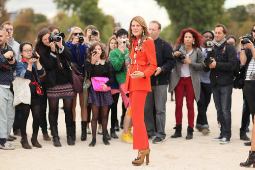 Anna Dello Russo's poppy-red hues drew a crowd outside the shows.