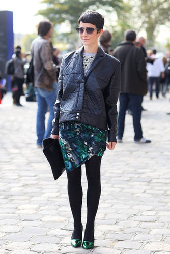 An artsy print countered a leather jacket, and green metallic heels furthered the effect.