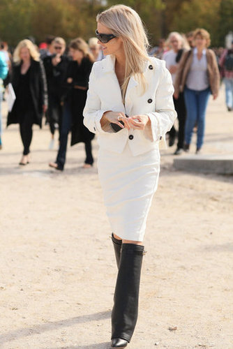 A sleek white skirt and coat played chic opposites to fashion-forward riding boots.