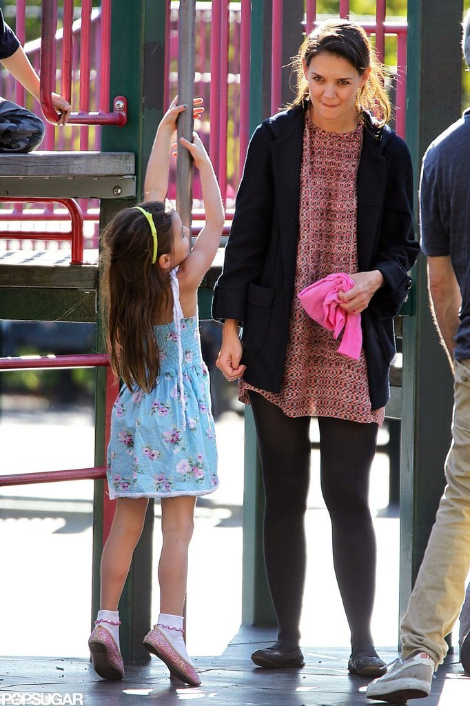 Katie Holmes watched over Suri while she played.