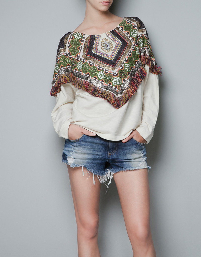 Calling all bohemian style-setters, this one's for you. Colorful embroidery, fringed edges, and cozy to boot? This is the ultimate free-spirit layering piece. Zara Embroidered Sweatshirt ($60)