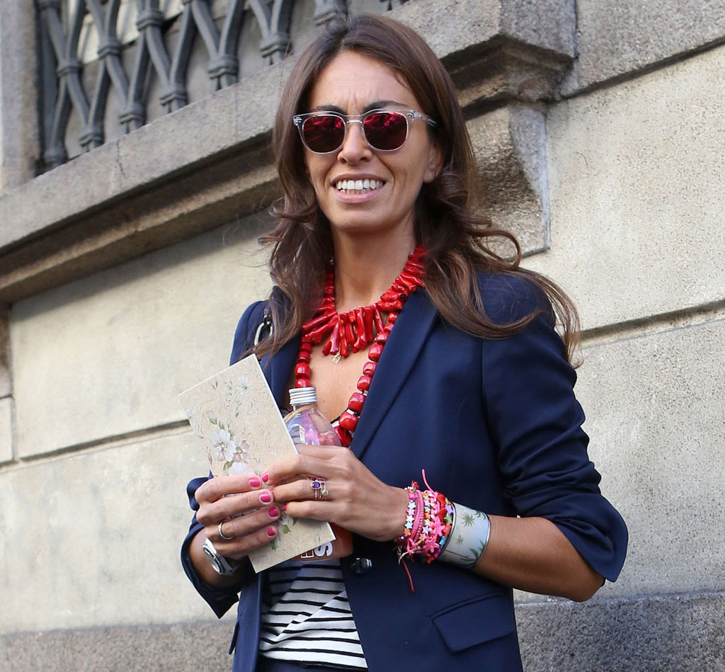 Layered coral necklaces gave stripes and suiting and eclectic edge, as did her mirrored sunglasses. Source: IMAXtree