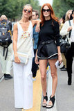 Taylor Tomasi Hill rocked a structural black mini skirt with her go-to cutout wedges. Source: Greg Kessler