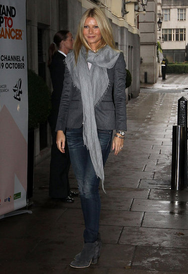 Gwyneth Paltrow wore a gray scarf with a gray blazer in London.