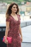 Penelope Cruz wore a pink printed dress to a photocall in Spain.