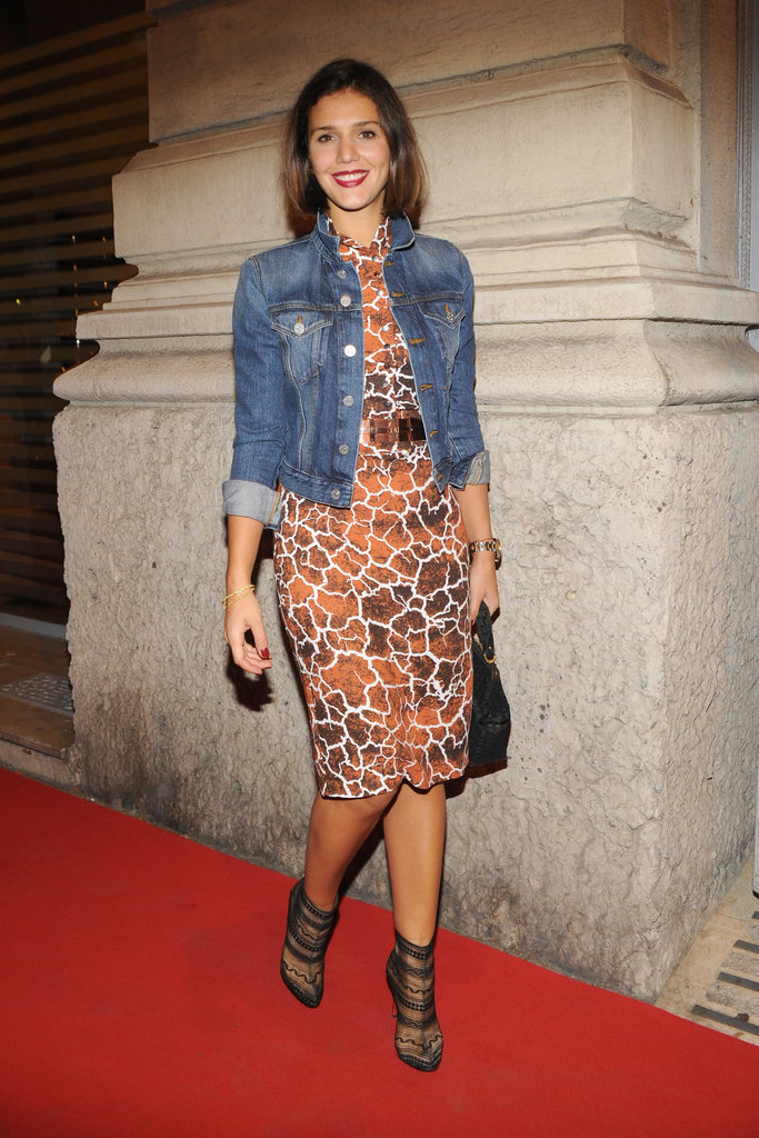 Margherita Missoni played to both a laid-back sensibility and a more formalized one. Case in point: her denim jacket offset her printed form-fitted sheath and sexy semisheer ankle boots to perfection.