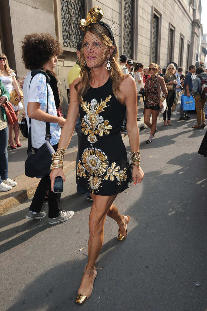 Anna Dello Russo was feeling particularly golden and it showed in her gold-embellished black dress, gold cap-toe shoes, and gold veiled hat.