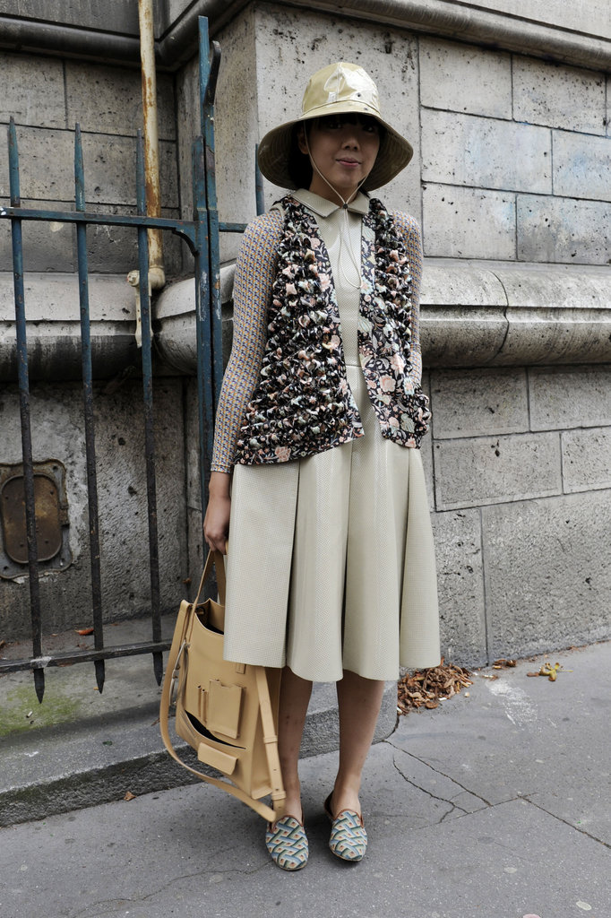Susie Bubble kept it ladylike in a collared midi dress and slippers.