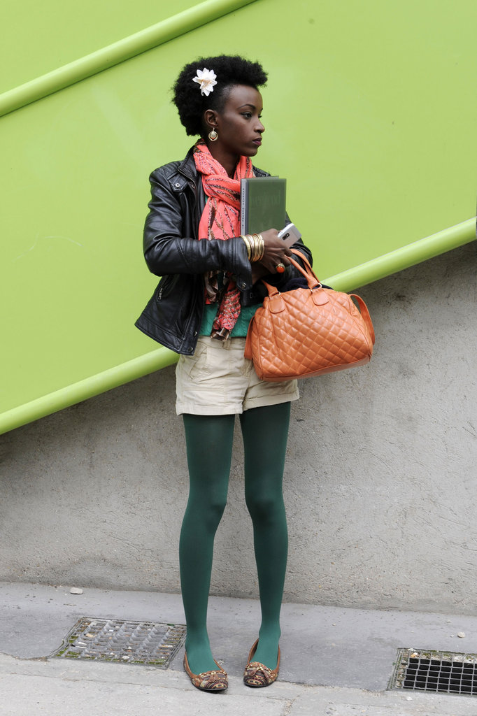 Green tights were the statement-making layer in this look.