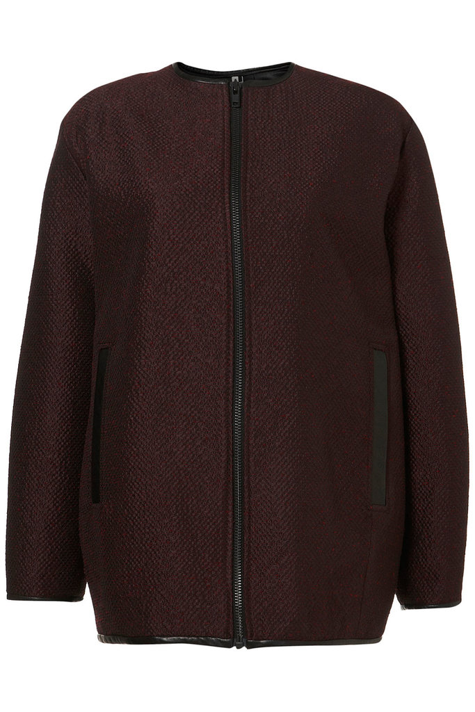 This plum-colored zip-up gets an even richer finish in jacquard. Just throw it on over a printed sheath dress and pumps for a workday-appropriate mix. Topshop Premium Jacquard Bomber Coat ($250)