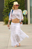 Gwen Stefani topped her bikini with a sheer white crop top while walking in Malibu, CA, in July 2012.