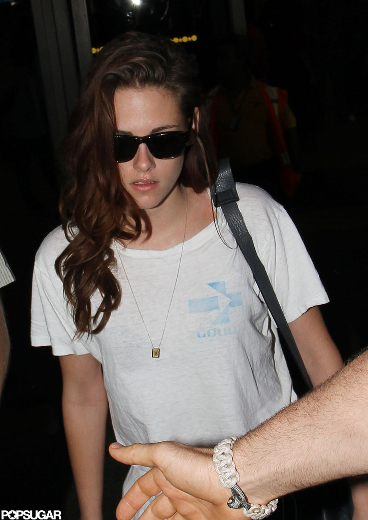Kristen Stewart wore her hair over to one side.