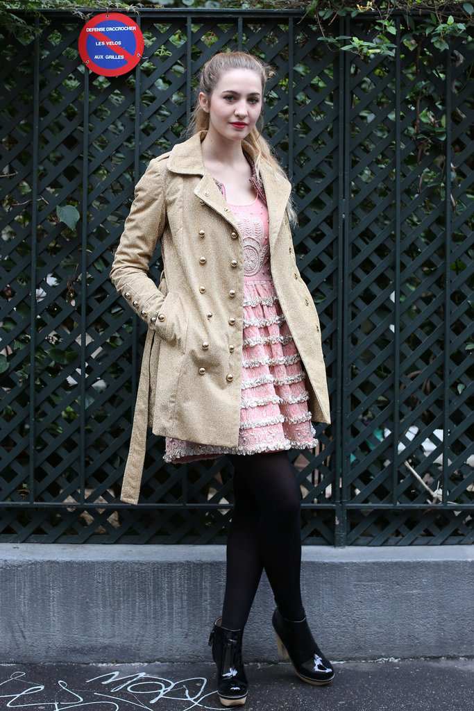 This gilded trench played right into the opulence of her little tiered dress.