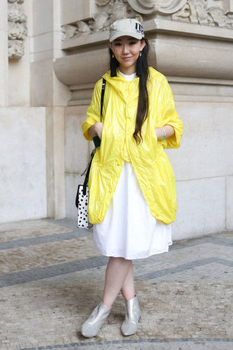Hardly mellow, this jolt of yellow livened up an easy white dress, while her futuristic booties gave it ample personality.