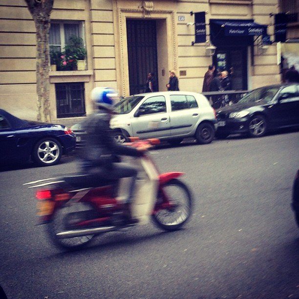 That's Isabel Marant scooting away in a leather jacket.