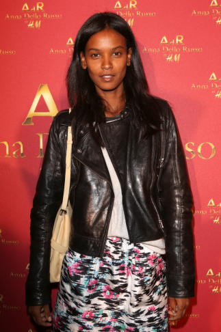Liya Kebede toughened up a colorful printed skirt with a black leather moto jacket. Source: H&M