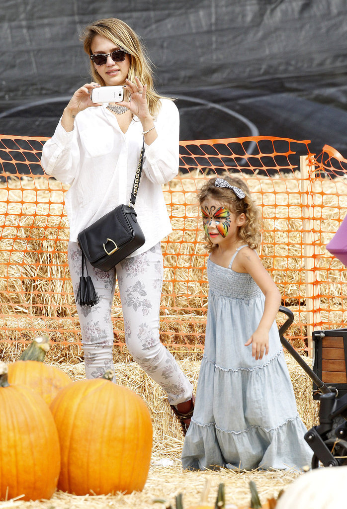 Jessica Alba snapped photos of Honor Warren with her face painted at Mr. Bones Pumpkin Patch in LA.
