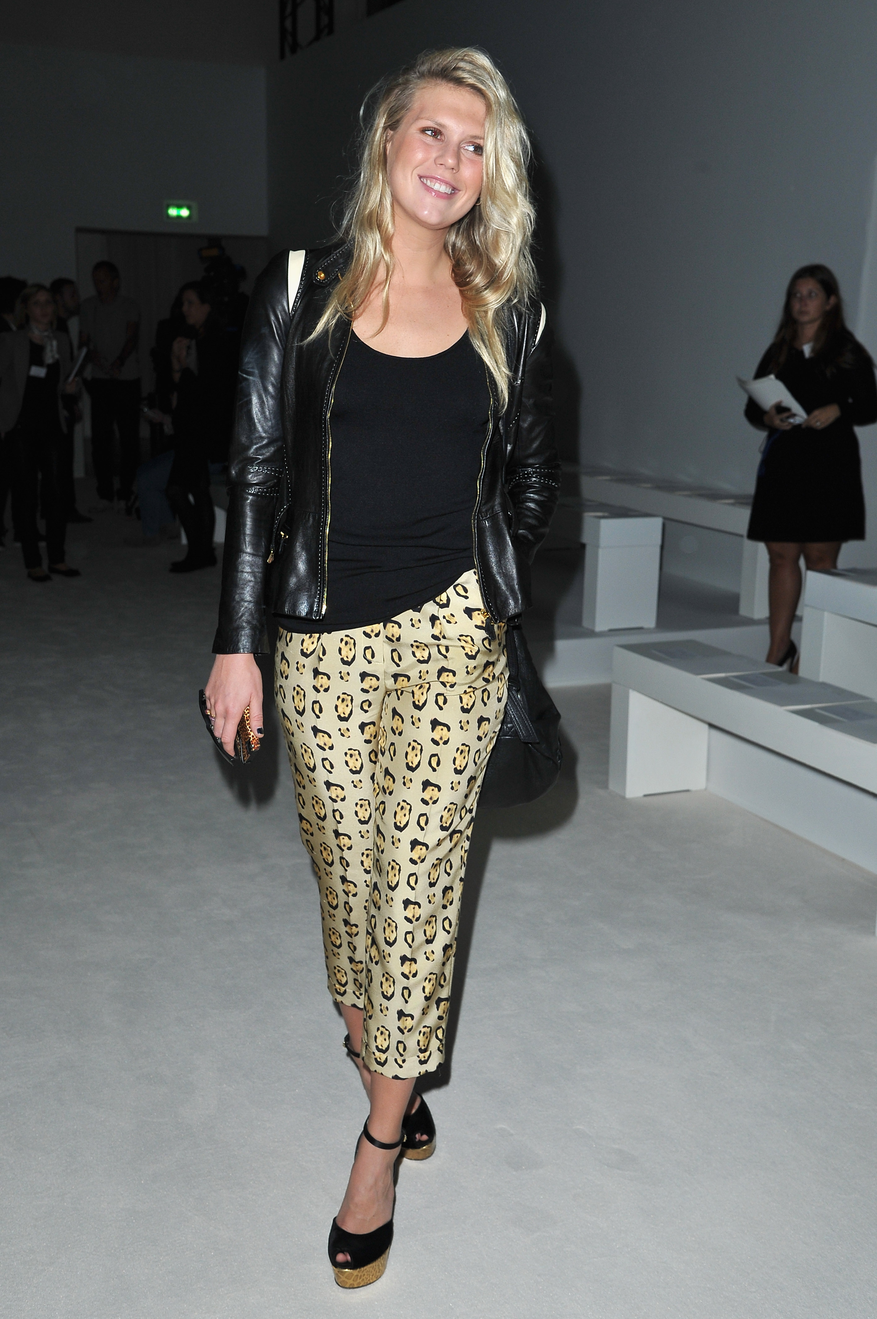 Alexandra Richards showed off her effortless style, and penchant for prints, in this tailored trouser look at Giambattista Valli. We're particularly loving her gold-platform sandals and leather jacket.