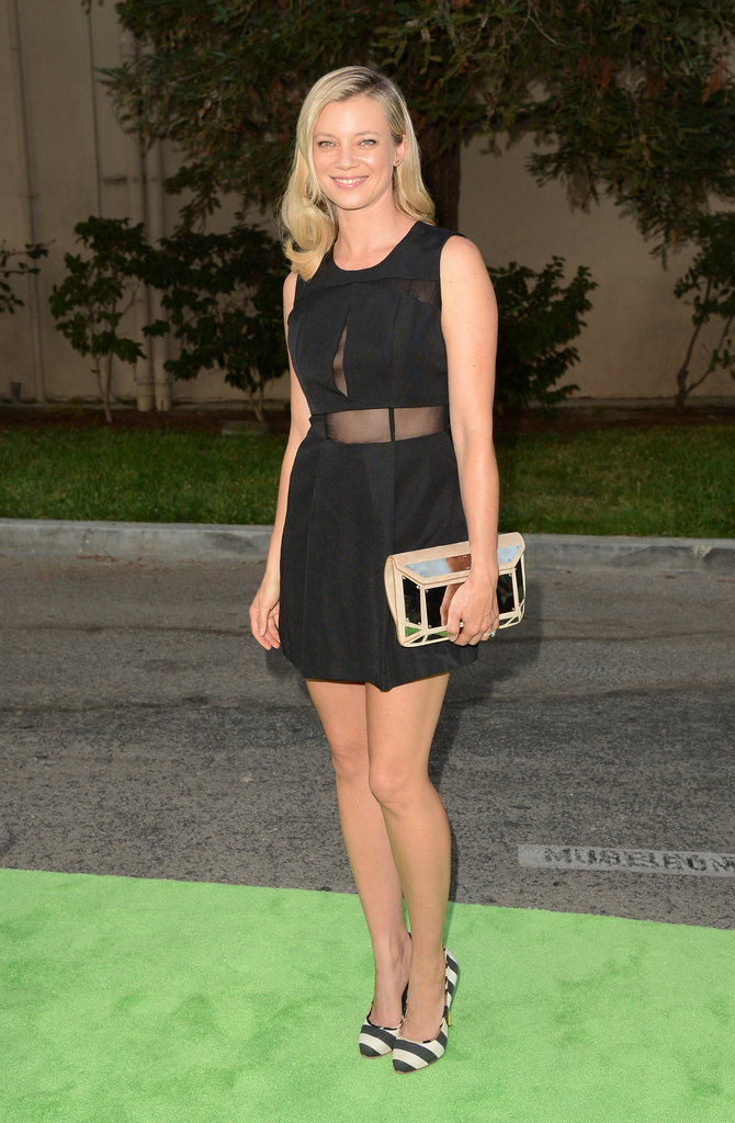 Amy Smart showed off a hint of skin (and some leg) via her sheer cutout-infused LBD. To finish the look, she wore striped pumps.
