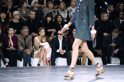 Emme Anthony hung onto mom Jennifer Lopez during the Chanel show at Paris Fashion Week.