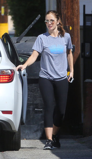 Minka Kelly hopped out of the car.