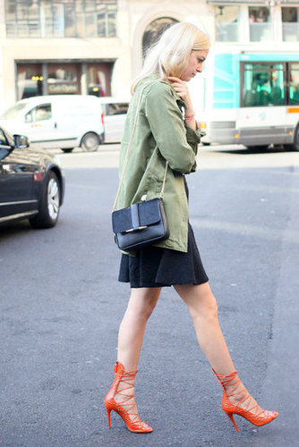 Proof that a great anorak goes with practically anything — here it tempers a ladylike dress and fiery lace-up heels.