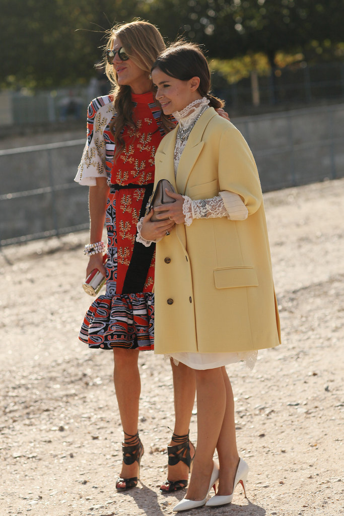 Fashion-forward duo Anna Dello Russo and Miroslava Duma make their mark in bold print and frills, respectively.