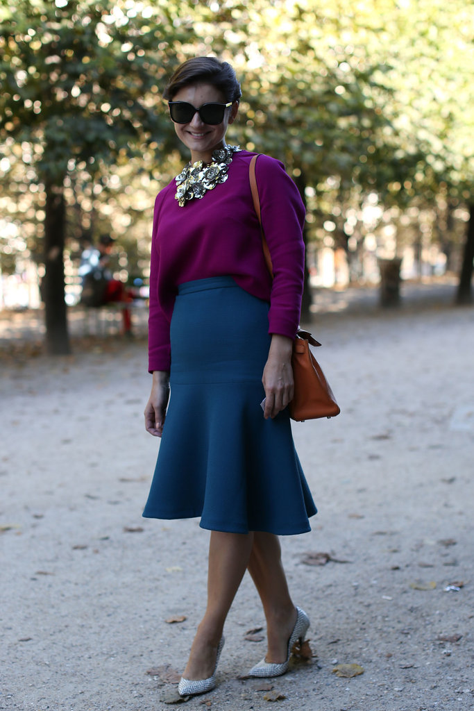 We love how this fluted skirt furthers the femininity of her floral metallic necklace.