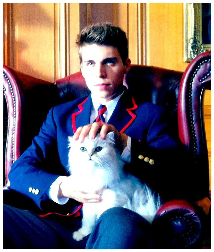 Ryan Murphy shared a picture of Glee's new Warbler, played by Nolan Gerard Funk. What's the deal with the cat? Source: Twitter user MrRPMurphy