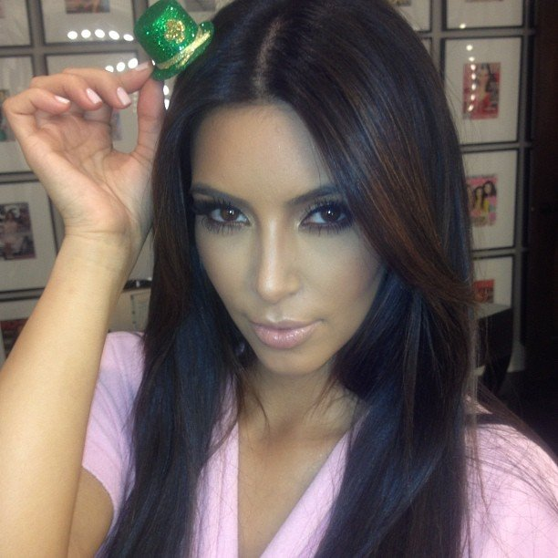 Kim Kardashian tried on a miniature green hat. Source: Instagram user kimkardashian
