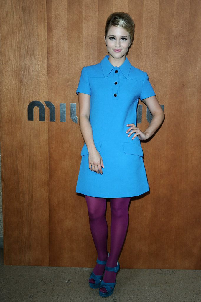 Dianna Agron paired a bright blue dress with purple tights to stop by the Miu Miu show during Paris Fashion Week.