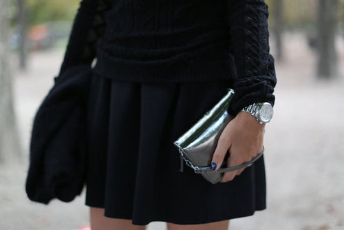 A mercurial clutch in hand added a flash of excitement to black.