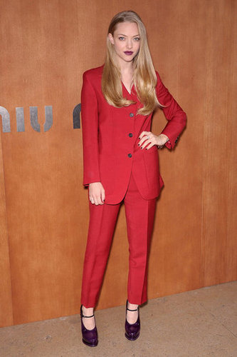 Amanda Seyfried chose a red pantsuit and Prada's rubber platform pumps for the Miu Miu show.