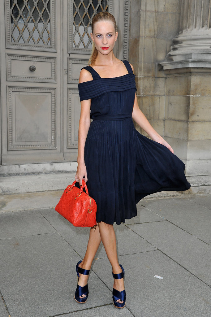 ... navy-blue off-the-shoulder dress with matching blue sandals. Her