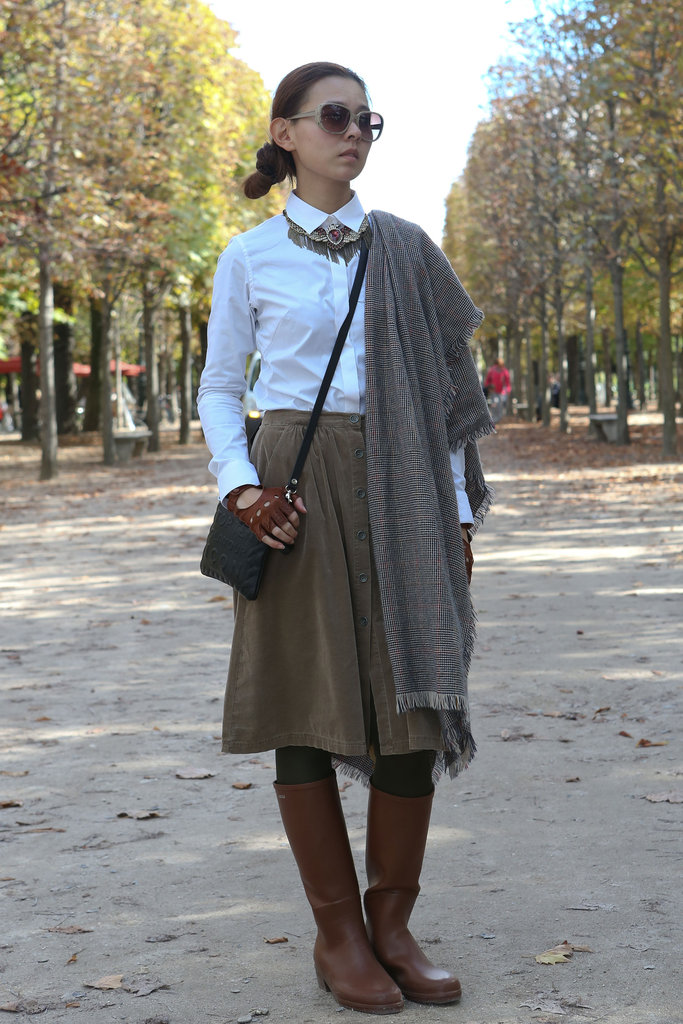 A vintage-feeling look thrown together with a corduroy skirt, plaid scarf, and a statement-making necklace.
