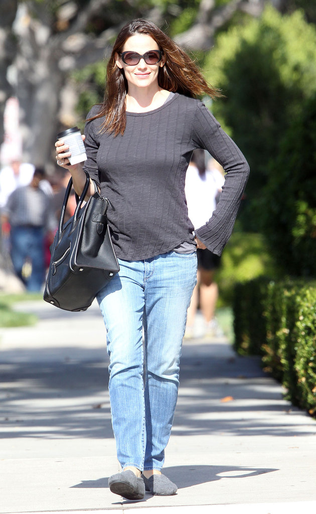 Jennifer Garner walked down the street with a coffee in her hand.