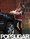 Pregnant Gisele Bündchen carried serving trays to her car in Boston.