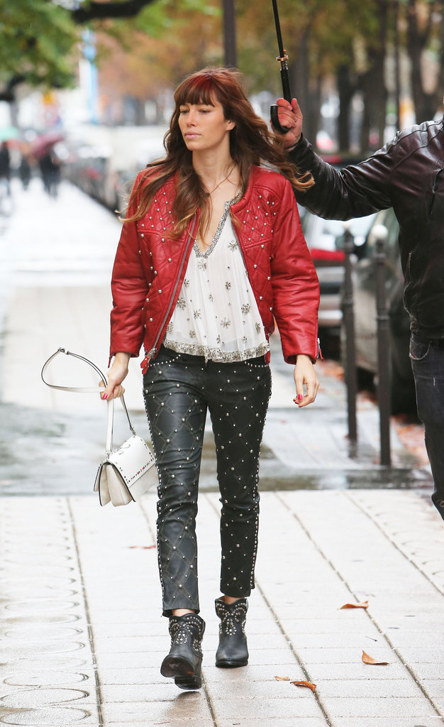 While shopping on Avenue Montaigne in Paris, Jessica Biel went edgy in a fully studded Isabel Marant ensemble — red leather jacket, sheer embellished top, and black leather pants.