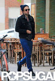 Robert Pattinson wore a cap and blue pants for an outing in NYC.