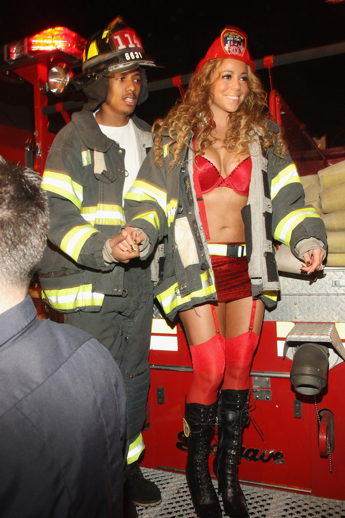 Mariah Carey and Nick Cannon brought the heat in firefighter costumes for a Halloween bash in 2008.