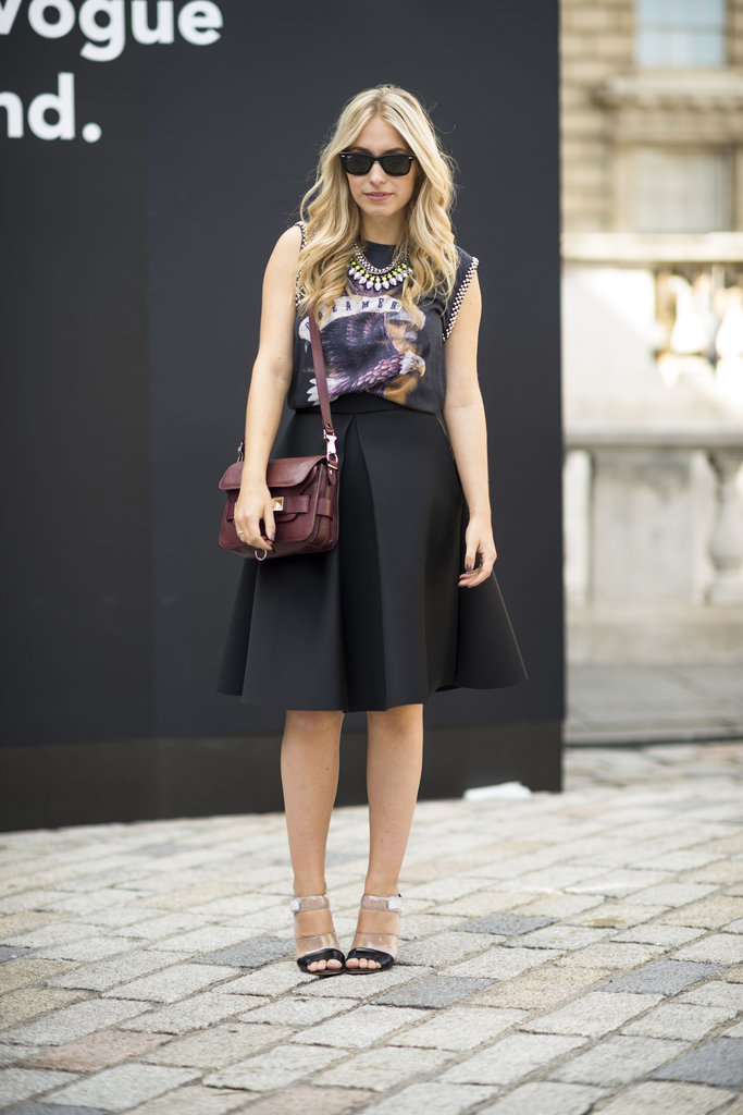 Rework a ladylike skirt with a vintage-feeling tee and statement jewels. A burgundy bag finishes it off with a quintessentially Fall feel. Source: Adam Katz Sinding