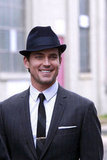 Matt Bomer flashed his sexy smile on the NYC set of White Collar in April 2012.