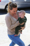 Hilary Duff carried baby Luca Comrie as she ran errands in Beverly Hills.
