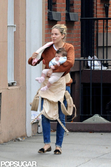 Sienna Miller held Marlowe in her arms.