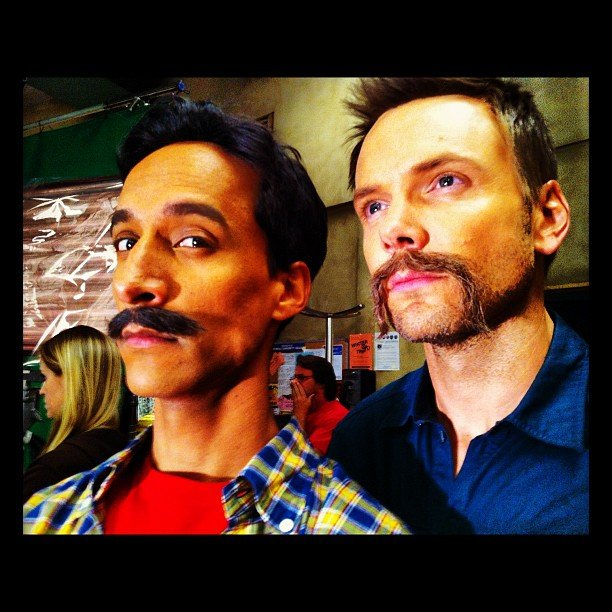 Danny Pudi and Joel McHale sported mustaches on the set of Community. Source: Instagram user sbasilone